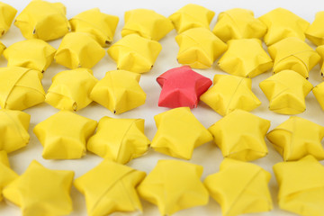 Individuality concept. Origami stars group, close-up