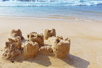 Destroyed sand castle on a beach. Spain
