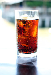 Cola in glass.