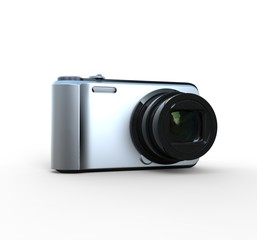 Small silver camera on white background