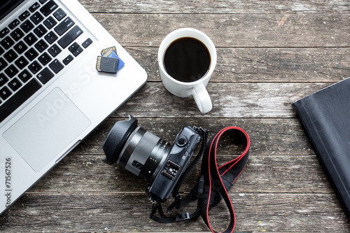 Laptop with digital camera and a coffee cup. - 71567526