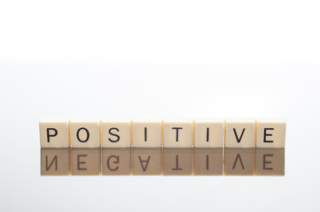 Letters spell Positive with Negative reflection