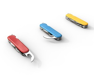 Red, blue, and yellow swiss army knifes on white