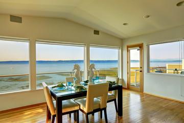 Luxury house interior. Bright elegant dining area with scenic ba