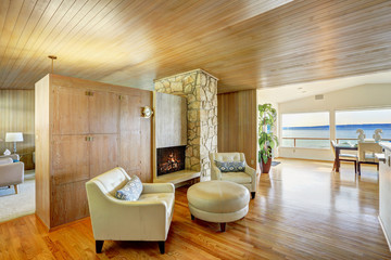 Beautiful house interior with wooden plank trim. Cozy sitting ar