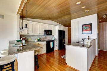 Kitchen area with paneled vaultd ceiling