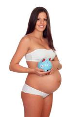 Brunette pregnant in underwear with moneybox