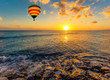 Hot air balloon over the sea at sunset - 71571142