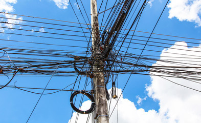 Photo of an electric pole with a many cables