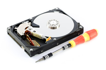 Black Hard disk and screwdriver isolated.