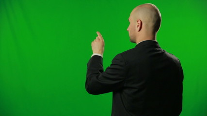 Man typing on a green screen.FULL HD.