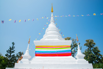 White pagoda decoration with multicolour ribbon in Nan province