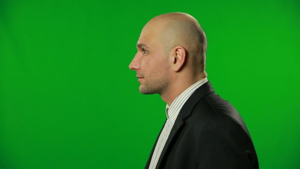 Amazed Businessman on a green screen.FULL HD.