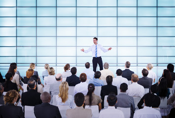 Businessman giving Presentation to his Colleagues