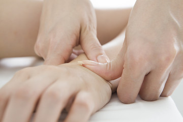 Massage press pot of arms with the thumb