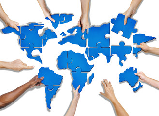 Hands Holding Jigsaw Puzzle Forming World