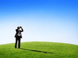 Business Man Observing Nature With A Telescope