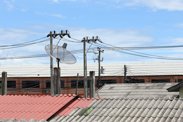 Satellite dish and TV antennas on the house roof with electricit