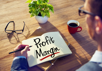 Man with a Note and a Word Profit Margin