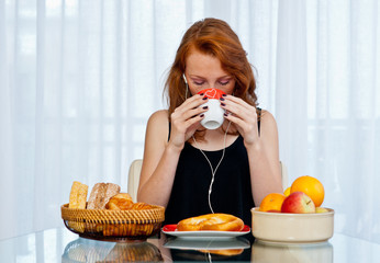attractive girl with freckles drinking from cup