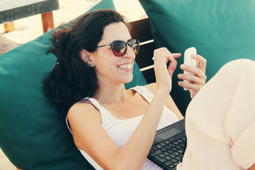 woman with laptop and smart phone