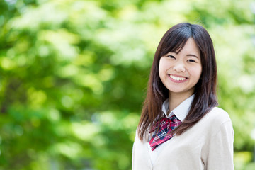 portrait of young asian student in the park