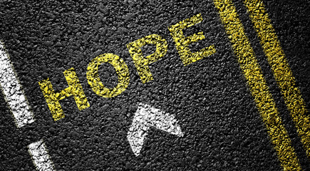 hope and arrow on the asphalt road