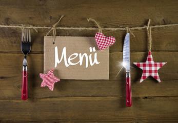 Weihnachten: Speisekarte mit Messer und Gabel zum Fest