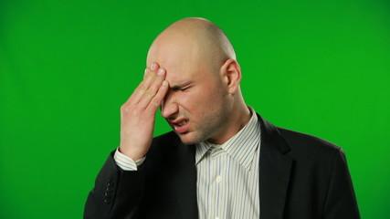 Bald businessman has headache, green screen. FULL HD