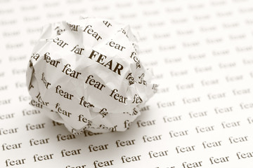 Crumpled paper ball with words fear
