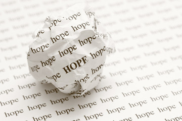 Crumpled paper ball with words hope