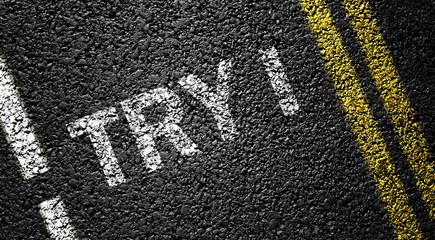 try sign on the asphalt road