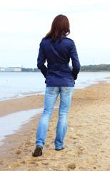 Brunette woman walking on the beach