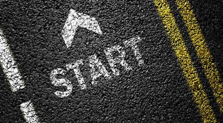 start and arrow on the asphalt road
