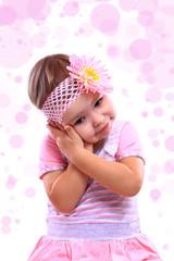 A closeup portrait of a happy little girl against