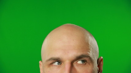 Male eyes on a green screen.FULL HD.