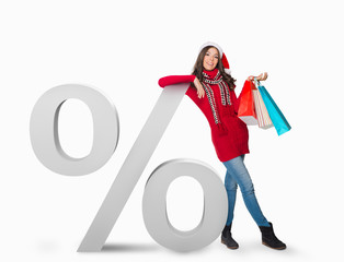 Woman standing next to a percent sign