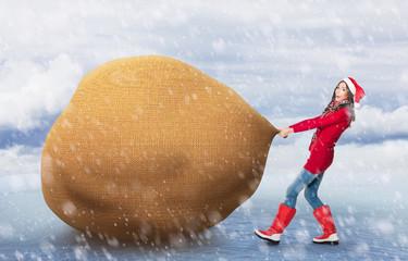 Woman pulling big Santa's bag