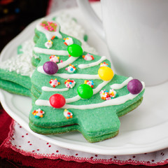 Christmas Tree Cookies on a White Plate with a Cup of Coffee