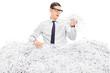 Worried man covered in shredded paper