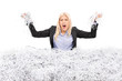 Angry businesswoman in a pile of shredded paper