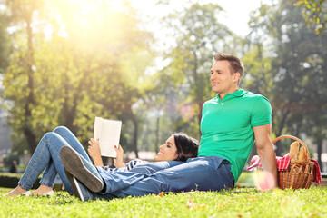 Boyfriend and girlfriend relaxing in park