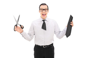 Overjoyed man with a cut tie holding scissors