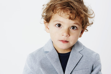 Smart young boy in suit jacket, portrait
