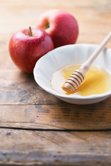 Acacia Honey and apples on wooden table