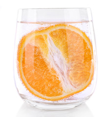 Orange in glass of water isolated on white