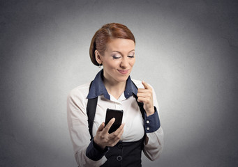 angry woman pointing with finger at smart phone