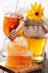Honey in jar, tea and honeycomb