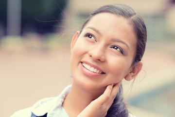 Headshot portrait daydreaming happy woman outside outdoors