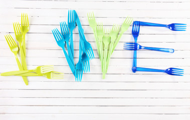 Love word formed with plastic disposable tableware